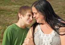 Boy holding onto mother's arm
