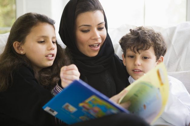 Mother reading with her daughter and son